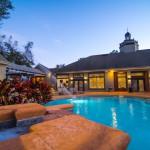 Real Estate dusk pool shot University Trails