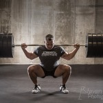 really strong guy squatting some weights